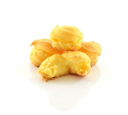 Cream puffs on white background photo