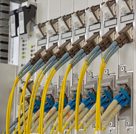 tcp ip: Fiber Optics with SCLC connectors. Internet Service Provider equipment. Focus on fiber optic cables. Data Network Hardware Concept.