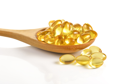 Cod liver oil omega 3 gel capsules isolated on white background