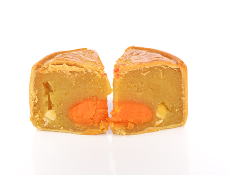 cut up: Mooncake with one cut up to show egg yolk for the chinese Mid-Autumn festival and white background