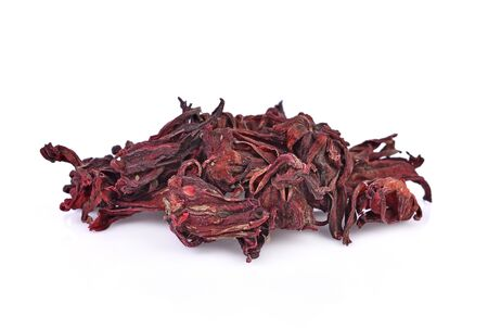 Dried hibiscus sabdariffa or roselle fruits on white