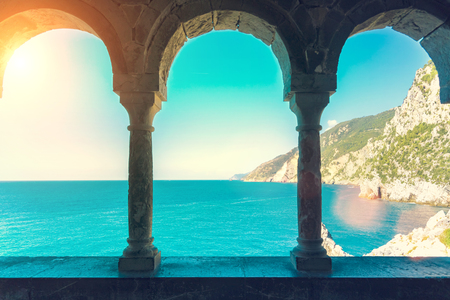 Sea view through the ancient stone arched window Stock Photo