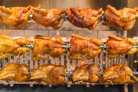 Grilled chickens on a spit, background