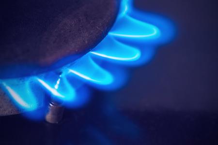 Gas burner flame at gas stove in the dark Archivio Fotografico