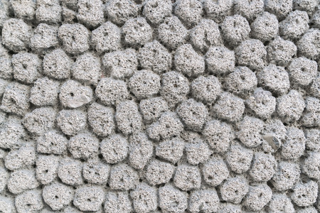 Relief porous stone surface, background, texture