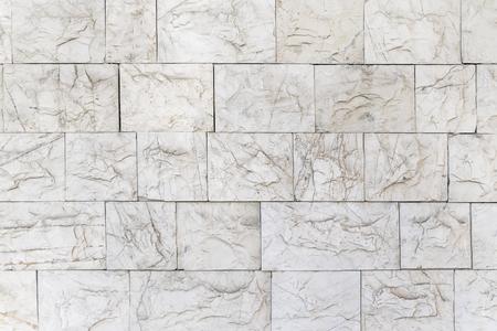 White relief stone tile, background, texture Banco de Imagens