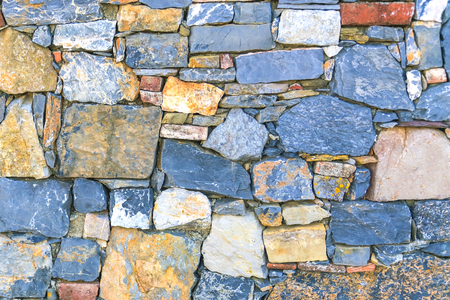 Blue and yellow stone wall, background, texture Banco de Imagens