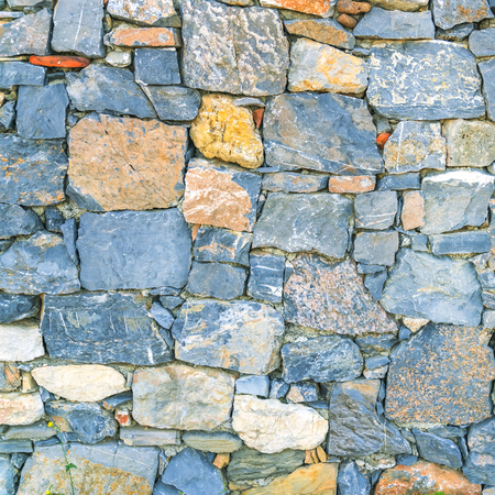 Blue and yellow stone wall, background, texture Stock Photo