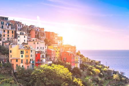 Beautiful hill top village of Corniglia in the Cinque Terre at sunset Stock Photo