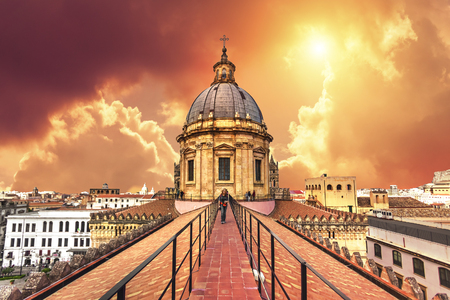 Woman on the roof of the Cathedral of Palermo during sunset Banco de Imagens