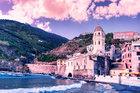 Vernazza village center with church and houses, Cinque Terre national park, Liguria, Italy. Toned