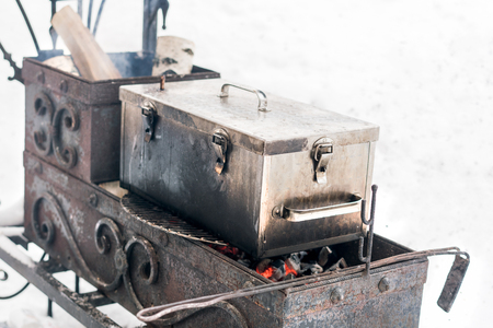 Metal box for smoking in the the brazier in winter Stock Photo