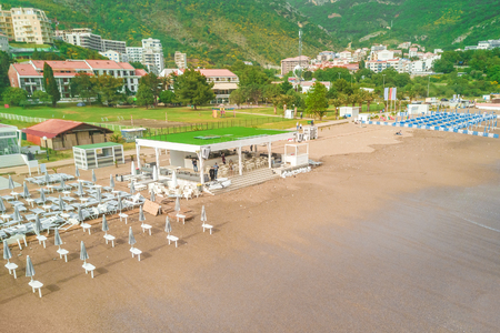 Sandy beach with sun beds, view from above