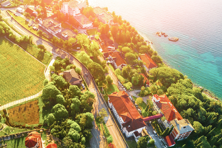 Ancient European city by the sea in the sunlight, view from above
