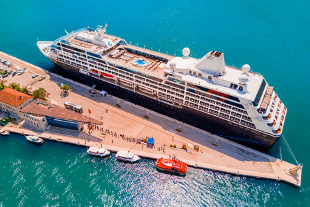 Large cruise ship at the pier, top view