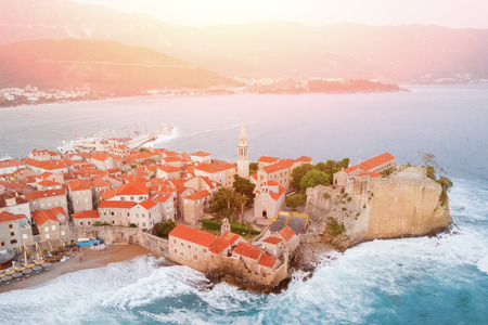 View from above of an ancient European city with a church by the sea in the sunlight, top view Stock Photo