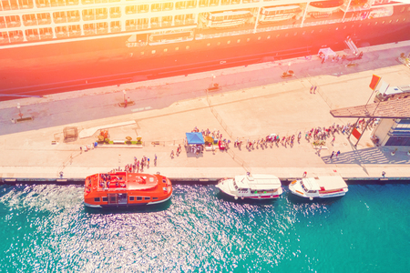 Top view of the berth with people and boats in the sunshine