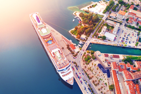 Cruise ship near the pier in the sunshine, top view
