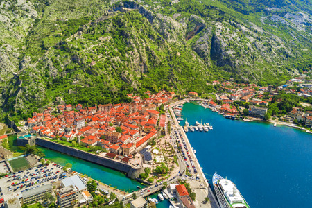 View from the height of the beautiful European city with a pier at the foot of the mountains