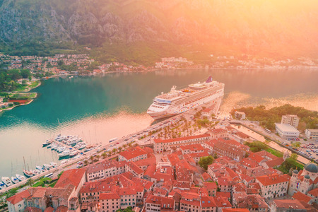 Top view of the large cruise liner at the pier. Old European city with a berth for yachts at sunset Stock Photo