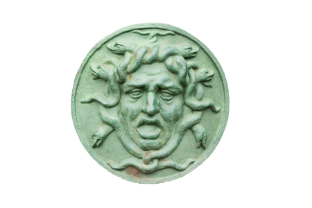 Bas-relief with the head of the Gorgon on a shield. Isolated on white Stock Photo