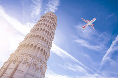 Airplane flying over Leaning Tower of Pisa in Italy