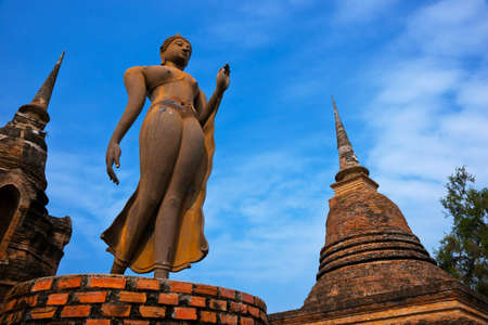 Buddhist sculpture. Buddha statue walking. Sukhothai Historical Park, Travel Asia. photo