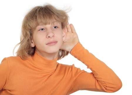 turtleneck: Teen in an orange turtleneck overhears, enclosing his hand to his ear