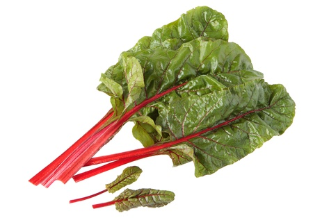 Red chard leaves in water drops on white background Standard-Bild