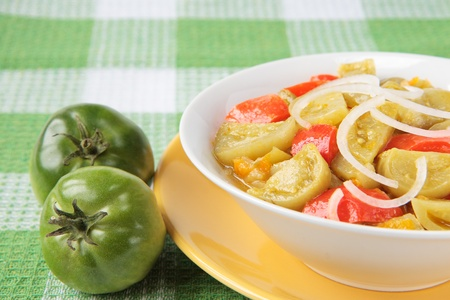 Appetizer of green tomatoes with paprika and onions
