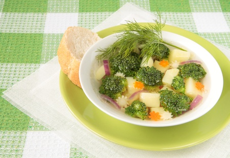 Broccoli soup with potatoes, carrots, parsley and dill