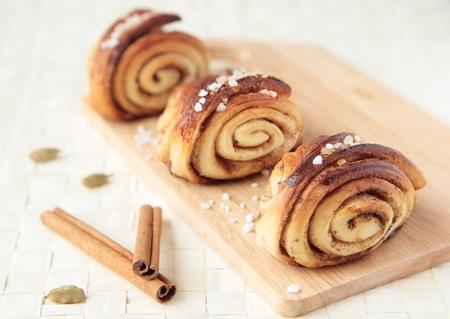 Three sweet rolls with cinnamon and cardamom Standard-Bild