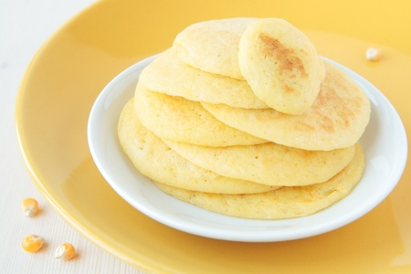 maize flour: A stack of pancakes made of maize flour on a yellow plate