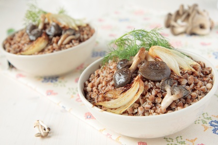 Buckwheat porridge with fried mushrooms and onions photo