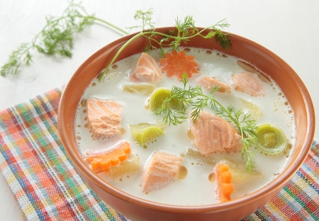 Salmon soup with cream, potatoes, carrots, dill photo