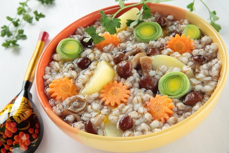 Soup with barley, mushrooms, potatoes, carrots, leeks