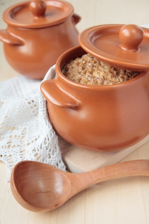 Barley porridge, baked with milk in a ceramic pot