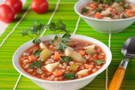 tomato paste: Soup with pickled cucumbers, barley  and tomato paste in  two bowl