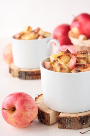 White bread pudding with apples and cinnamon in cups photo