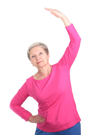 duffle: Cheerful elderly woman doing gymnastic exercises vigorously