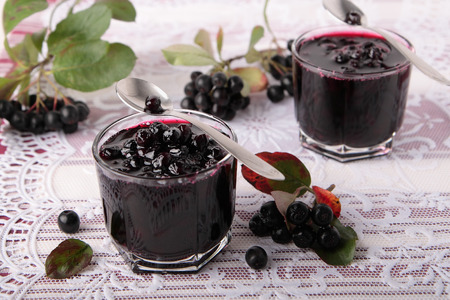 Black chokeberry jam in two small glasses Stock Photo