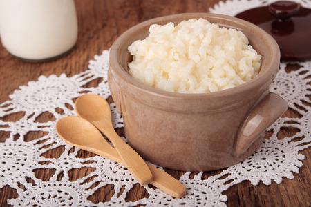 saucepan: Ceramic saucepan with sweet milk rice porridge