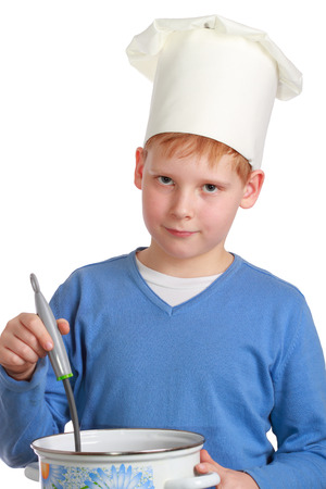 upper half: The red-haired boy in a chefs hat with a ladle and pan