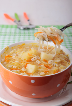 pearl barley: Soup of sauerkraut with pearl barley, potatoes in a bowl
