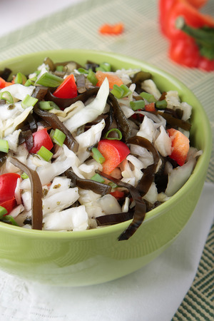 spring onions: Salad of cabbage with laminaria, sweet pepper and spring onions in a bowl