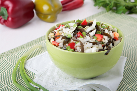 girdle: Salad of cabbage with laminaria, sweet pepper and spring onions in a bowl