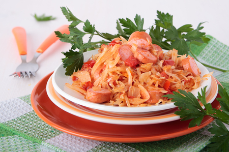 Sauerkraut, stewed with tomatoes, onions and sausage on a plate