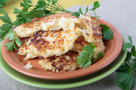 Stack of cabbage cutlets on a ceramic plate