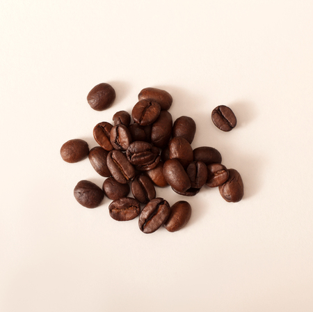 Closeup photo of coffee beans on white table