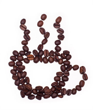 Closeup of Cup made of cofee beans on white background